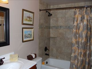 Frisco house photo - One of our custom tiled bathrooms between speedracer room and queen room