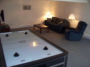 "Family Room with 42"" Plasma TV, Air Hockey table and pull out Queen sleeper sofa"