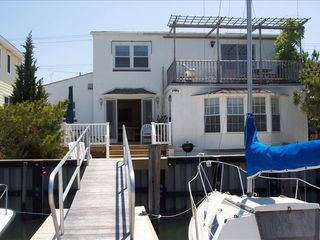 Stone Harbor property rental photo - Bay Front Elevation - Sea Breeze, Sun, Birds, Landscaping