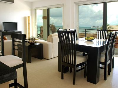 Puerto Morelos condo rental - Dining room seats 6; sofa bed in living room.