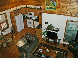 Columbia Falls cabin photo - View of dining, kitchen and living area from loft.