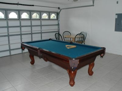 air-condtioned garage with pool table