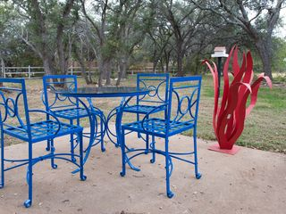 Dripping Springs house photo - Backyard patio and outdoor dining set.