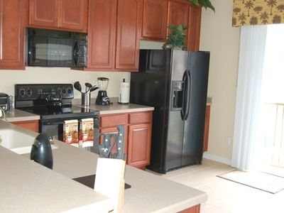 Modern Kitchen With All The Modern Appliances & Bistro Table