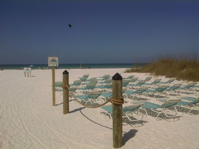 An abundance of beach chairs on your private beach area. Feel free to move chair