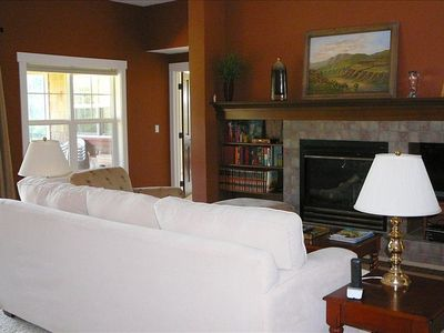 The living room with gas fireplace and bookcase with entertainment center.