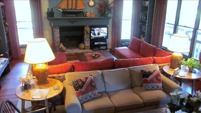 Opposite end of great room reveals 2 conversation areas with fireplace and TV.