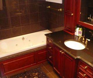 Master bathroom with cherry wood cabinetry