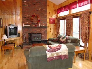 Ludlow chalet photo - Open floor plan with vaulted ceilings & wood burning fireplace