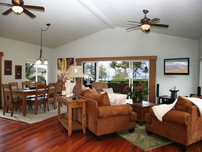 Living room and dining room opening to lanai with ocean views