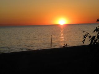 Pentwater cottage photo - A beautiful sunset seen from the bluff just across the road from the cottage.
