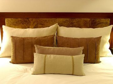 Custom made headboard, down pillows, down comforter, and handmade artisan linens