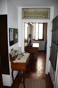Entrance with doors to all rooms, antique desk with ADSL-WiFi router and phone