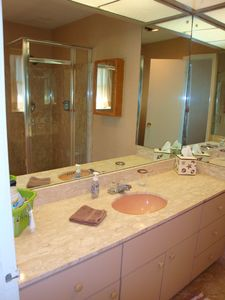 Master bath has large vanity and walk in shower