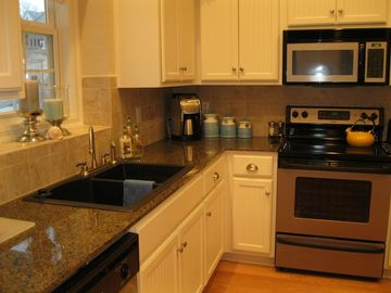 A Well Appointed Kitchen with Serving Dishes that will make you smile.