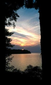 Sodus Bay cottage rental - Lovely sunsets are seen as sun sets over the point where eagles nest.