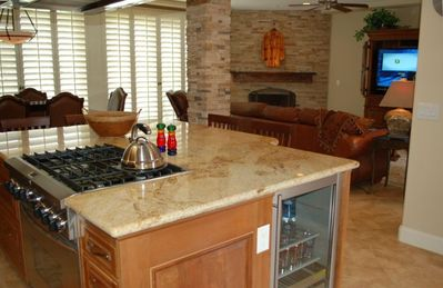 Large island kitchen keeps you connected with your guests.