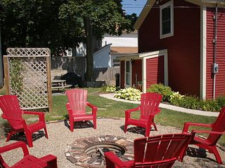 Muskegon house photo - Redbird Cottage - BBQ grill in shadow, fire pit, picnic table - Smore's!