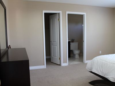 Master bedroom with separate bathroom and walk-in closet.