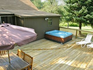 Berkeley Springs cabin photo - Large deck with spring water filled hot tub, swing