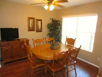 The formal dining room has a HD TV. Great place for dining or playing cards
