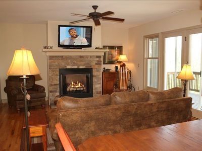 Living Room with Flat Screen Television, Gas Log Fireplace, Picture Windows