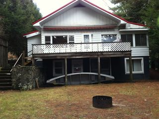 Back shot of the house. We have a canoe and two kyacks for your boating pleasure