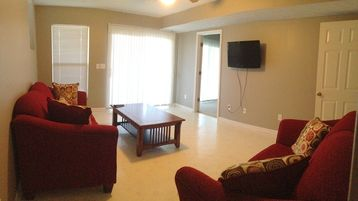 Living Room #2 -- includes flat-screen TV with built-in DVD player.