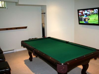 Rec room with pool table and TV