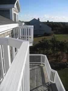 2 upper balconies, 1 large deck with grill