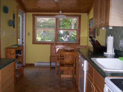 Kitchen area with breakfast nook and seating for four