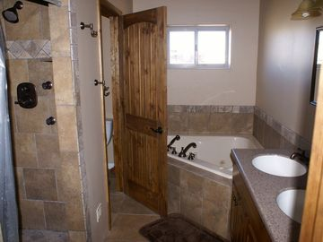 Master Bath with Jetted Tub and Dual Shower.