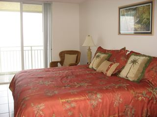 Indian Harbour Beach condo photo - Master bedroom with king bed opens onto balcony