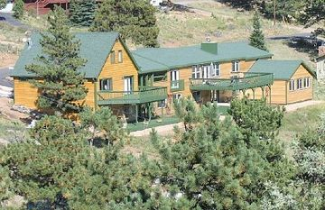 Estes Park house rental - back of home on over an acre of abundant wildlife.