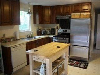 Brewster house photo - Updated kitchen with stainless frig, stove, microwave, and dishwasher.