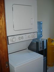 Bavaro condo photo - Laundry area with washer/dryer and water cooler