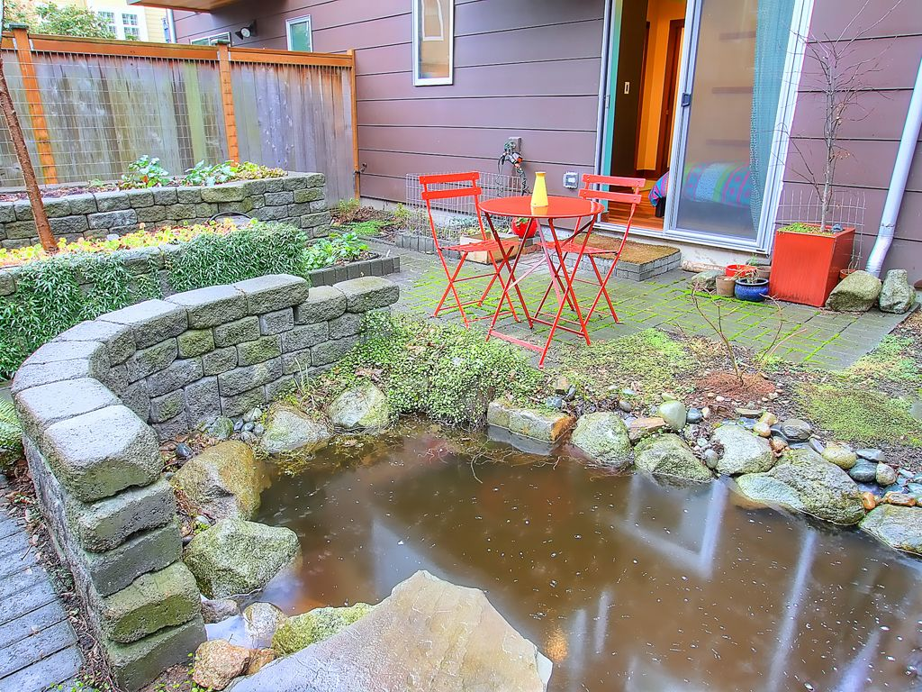 Chefs kitchen rooftop deck koi pond fireplace vrbo for Koi pond deck