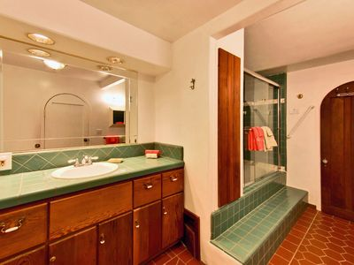 Take a long, hot bath. Note door to alcove/twin room.