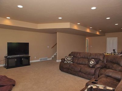 LG BASEMENT REC RM (SECTIONAL, LG HD TV, GMS, HOT TUB OUT BACK)