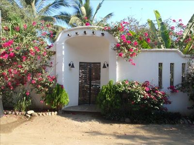 Private, secure front entrance with beautiful traditional Mexican architecture.