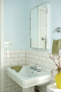 Pedestal sink in classically tiled bathroom
