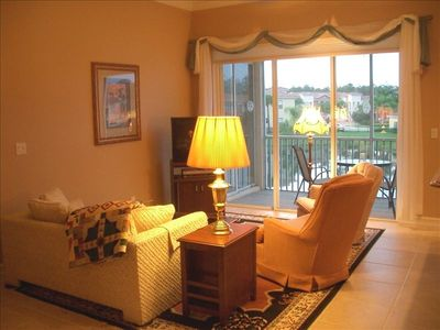 Comfortable living RM with TV, DVD player, triple glass doors open onto lanai