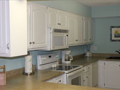 well equipped gallery style kitchen