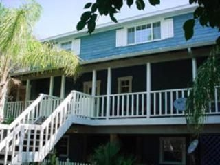 Key West style home with wrap around porch.
