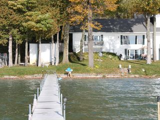 Burt Lake house photo - View of front of the house from the dock