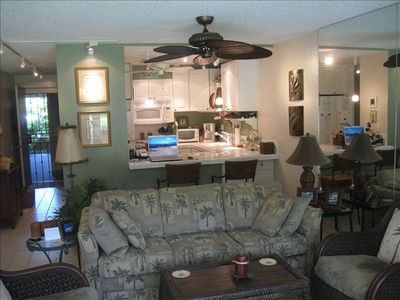 Living room, barstool eating area and kitchen