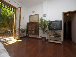 Bologna apartment photo - The living room - antiques, craft, modern tech.