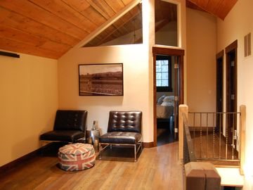 Upstairs loft, sitting area with leather chairs