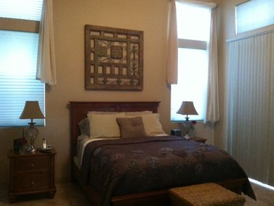 Master Bedroom w/queen bed, large walk-in closet, cable, sliding door to patio.
