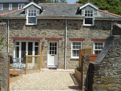 Lovely stone detached cottage in private courtyard garden with water views